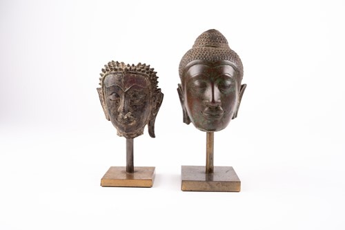 Lot 32-Two bronze busts of Buddha, 18th/19th century,...