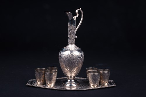 Lot 5-An Eastern white metal ewer, with six...