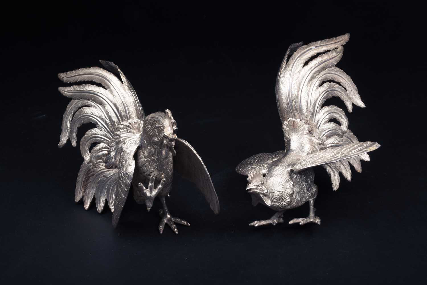Lot 41-A pair of silver fighting cocks, realistically...