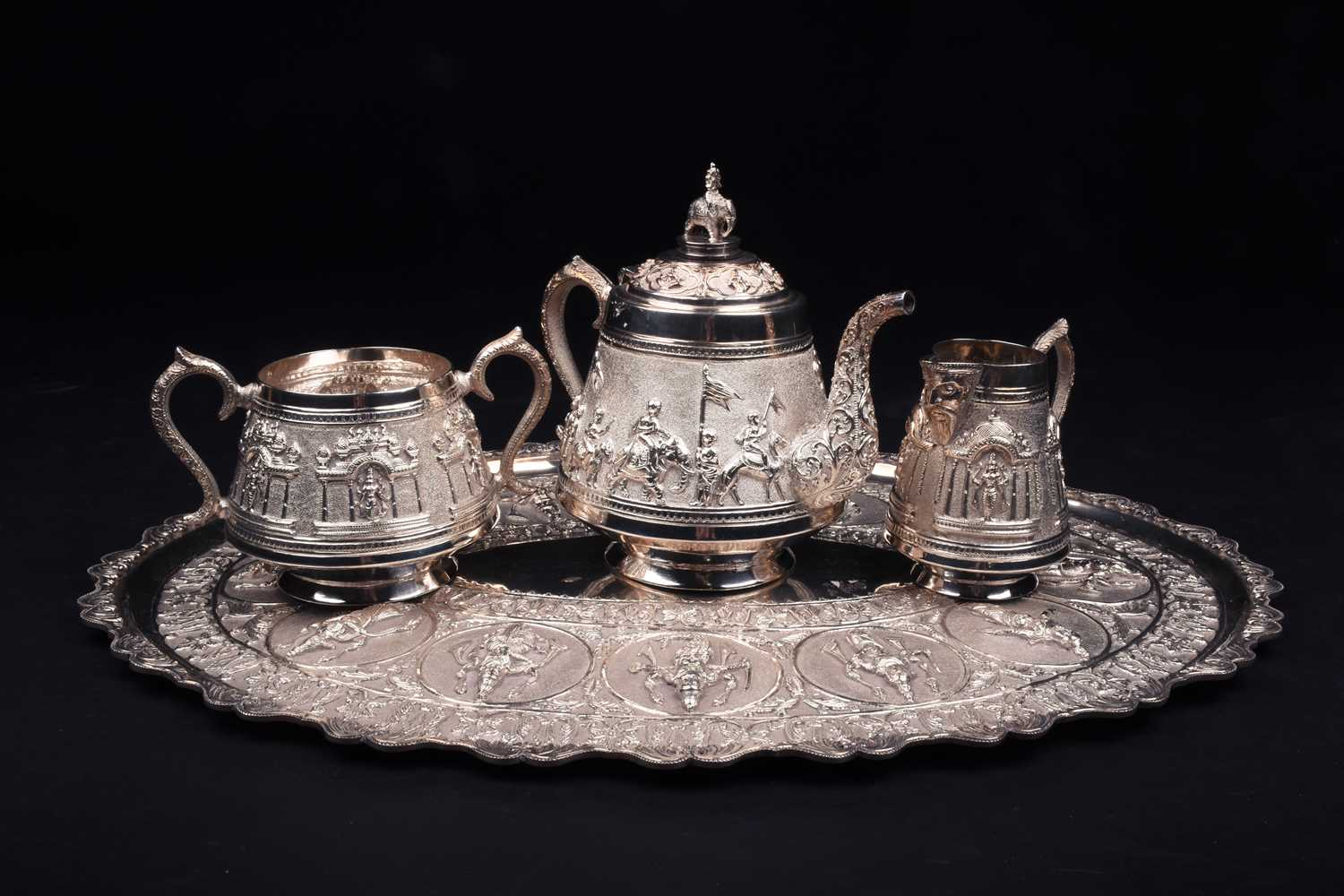 Lot 36-An Indian white metal three-piece teaset and...
