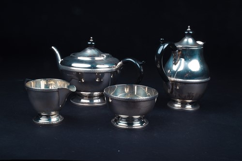 Lot 6-A George V silver four-piece tea set,...