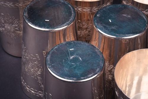 Lot 18-A set of twelve Continental silver beakers,...