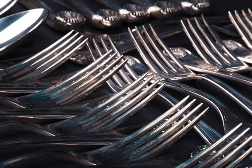 Lot 37-A suite of sterling silver cutlery by Calegaro...