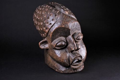 Lot 35 - A Bamileke helmet mask, Cameroon, an...