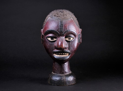 Lot 60 - An Ejagham (Ekoi) leather bound carved wood...