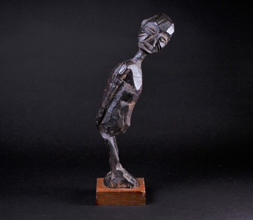 Lot 58 - A Lobi standing figure of a man, Burkina Faso,...
