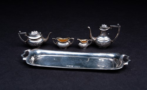 Lot 24-A novelty silver miniature tea set, comprised...
