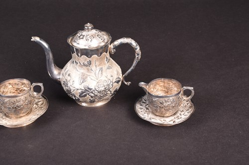 Lot 26-A Chinese silver part tea set, comprising...