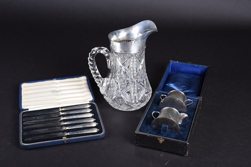 Lot 38-A silver mounted cut glass water pitcher,...