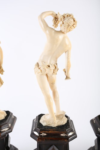 Lot 397 - A group of four 19th century European ivory...