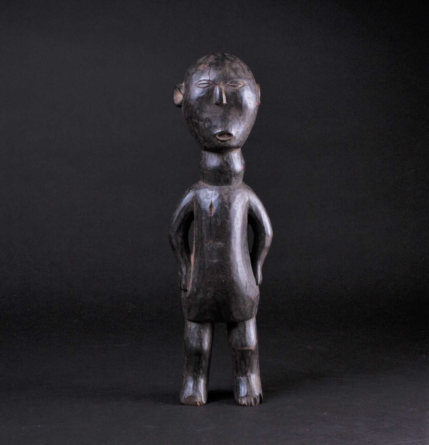 Lot 16 - An East African carved wood standing figure of...