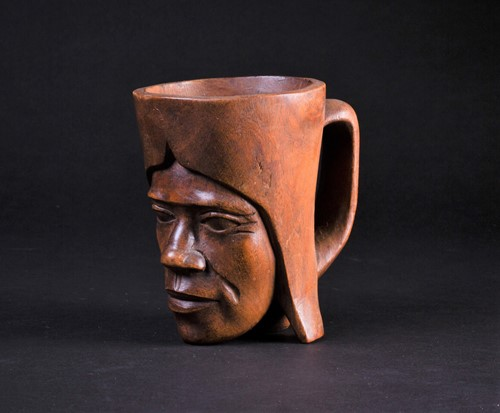 Lot 65 - An African carved wood palm wine cup, third...