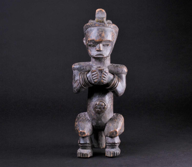 Lot 48 - A Fang Byeri figure, Gabon, with long coiffure,...
