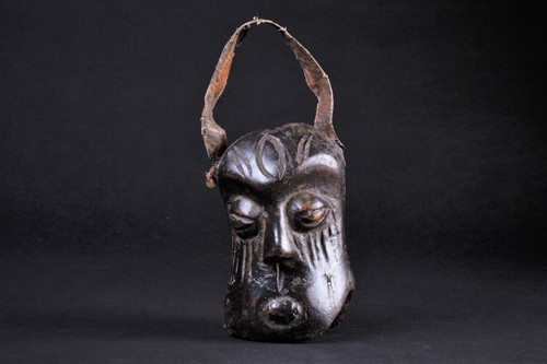 Lot 54 - An African carved wood miniature mask/bell,...