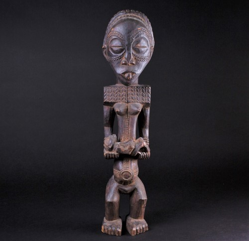 Lot 51 - A carved wood Bembe standing maternity figure,...