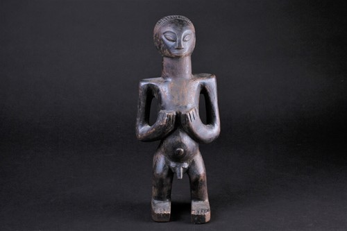 Lot 38 - An East African standing male fertility figure,...