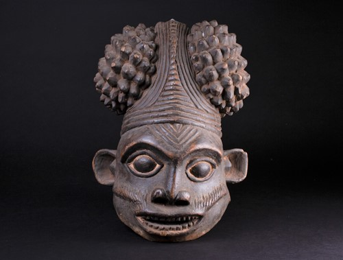 Lot 73 - A Bamum Bangwa carved wood mask, Cameroon, the...