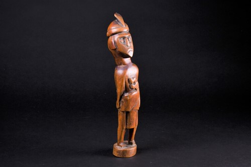 Lot 32 - A Malaysian carved wood standing figure of a...