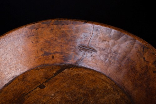 Lot 28 - An Indian carved wood bowl, the rim...