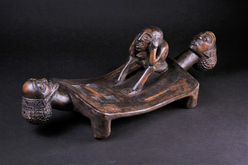 Lot 68 - A Chokwe carved wood head rest, in the form of...