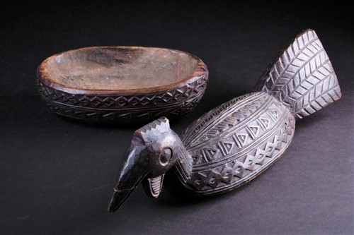 Lot 19 - A Yoruba carved wood box in the form of a bird,...