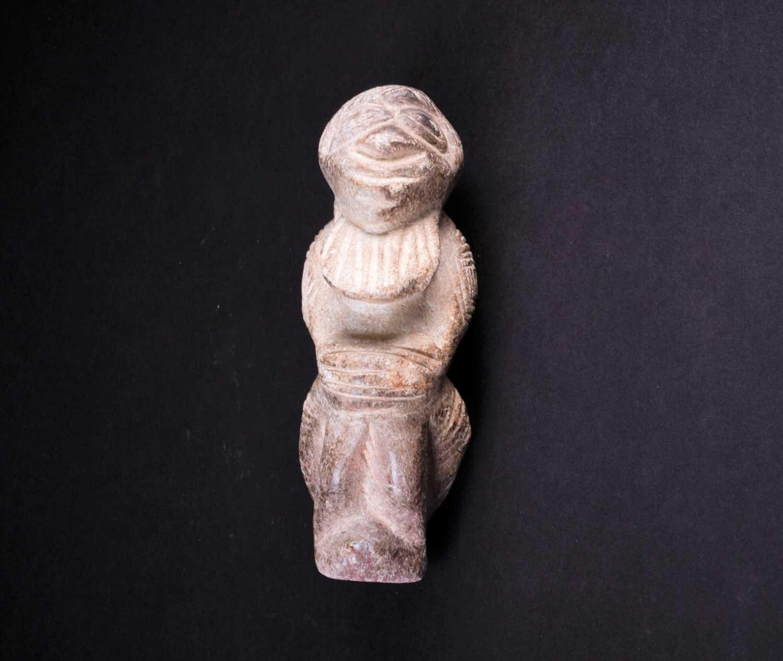 Lot 9 - A carved stone Nomoli figure, Sierra Leone,...