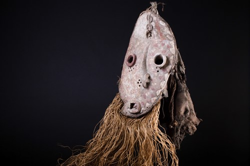 Lot 31 - A Pende sickness mask, the remnants of...