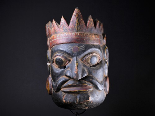 Lot 57 - An Indonesian carved and painted ceremonial...