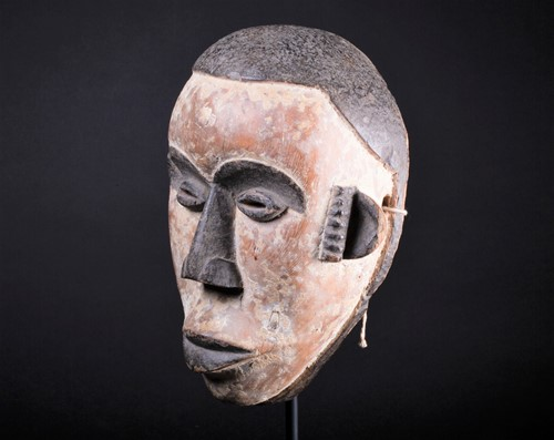 Lot 13 - An Igbo mask, Nigeria, with short coiffure,...