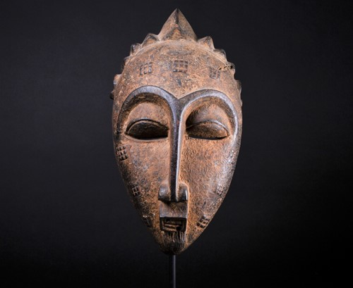 Lot 50 - A Punu mask, Gabon, with short linear coiffure...