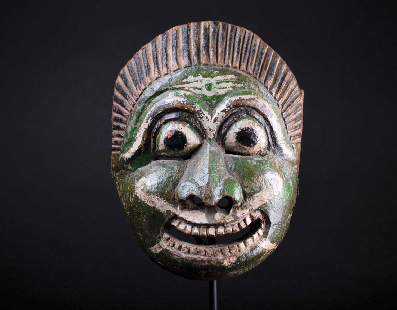 Lot 30 - An Indonesian carved and painted wood mask,...