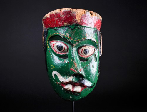 Lot 56 - An Indonesian carved and painted wood sickness...