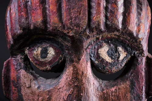 Lot 14 - A carved and painted wood zoomorphic mask,...