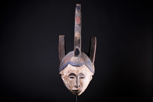Lot 24 - An Igbo Maiden Spirit mask, Nigeria, in red,...