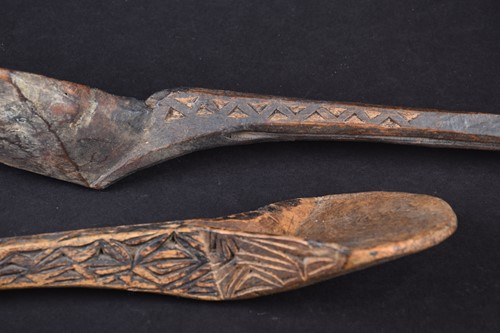 Lot 27 - Two African carved wood spoons, each with...