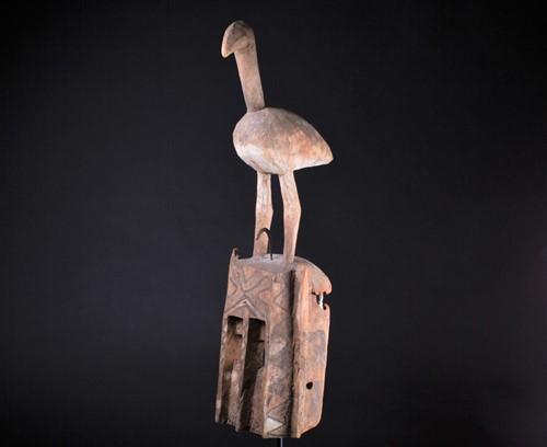 Lot 34 - A Dogon mask, Mali, surmounted by a large bird...