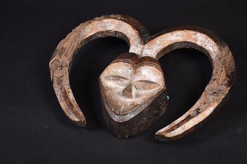 Lot 40 - A Kwele mask, Gabon, the mask with narrow eye...