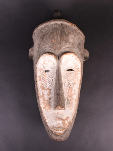 Lot 70 - A fang mask, Gabon, the long face with kaolin,...