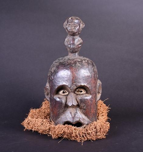Lot 4 - A Bamum Janus mask, Cameroon, with kaolin...