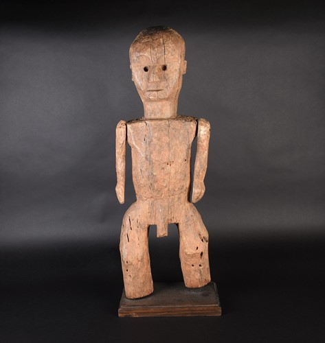 Lot 71 - A large African carved wood male fertility...