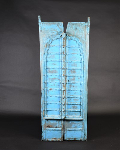 Lot 75 - A pair of North African painted wood window...