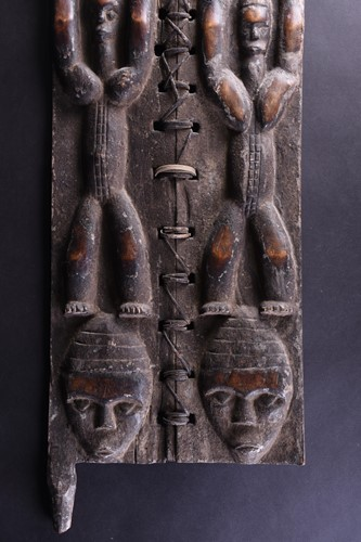 Lot 33 - A Baule attributed carved wood granary door,...
