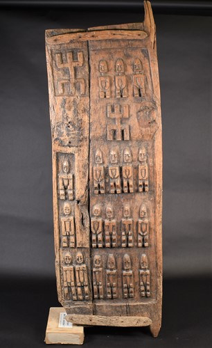 Lot 29 - A Dogon carved wood door, Mali, carved with...