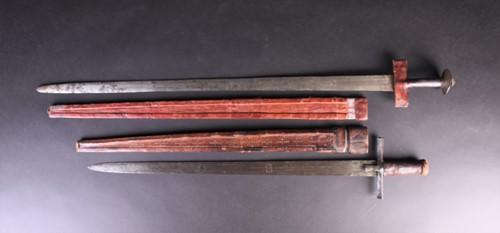 Lot 77 - Two Sudanese Tuareg Takouba swords, the...
