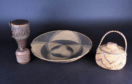 Lot 92 - A large South African woven straw shallow bowl,...