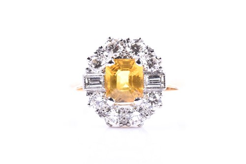 Lot 42 - A diamond and yellow sapphire cluster ring,...