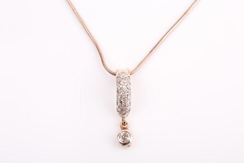 Lot 6 - A diamond-set pendant, the curved pave-set...