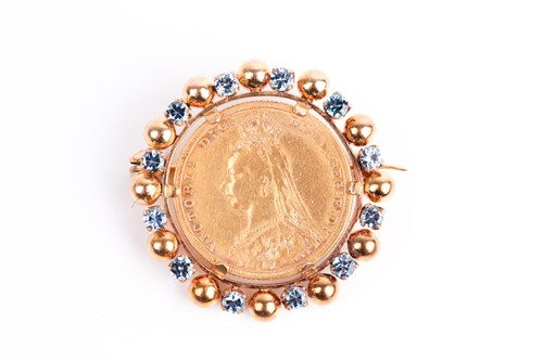 Lot 8 - A yellow metal mounted sovereign brooch, set...