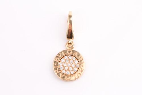 Lot 17 - Bulgari. A gold and pave set diamond pendant,...