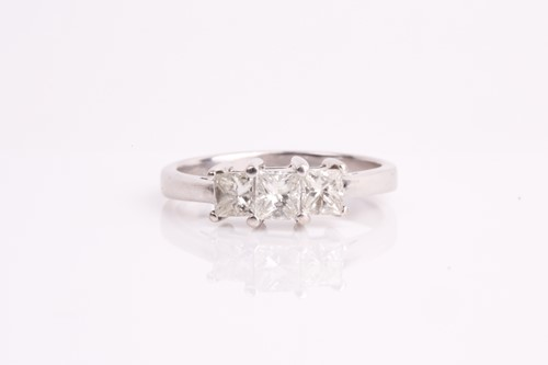 Lot 24 - An 18ct white gold and diamond ring, set with...